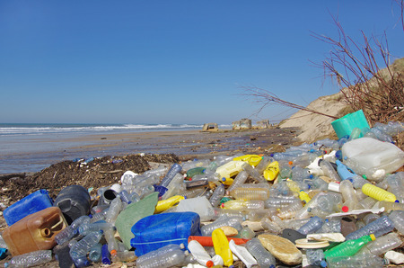 garbages, plastic, and wastes on the beach after winter storms Standard-Bild