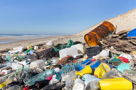 garbages, plastic, and wastes on the beach after winter storms.