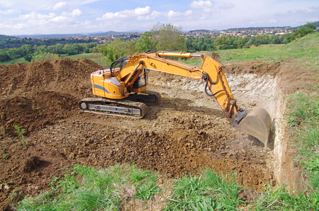 Excavator in action during earth moving works