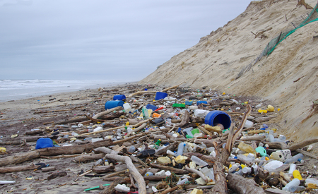 Garbages, plastic, and wastes on the beach after winter storms. Atlantic west coast of france. Every day, waste accumulates on the beach of Atlantic west coast, they arrive from Spain with ocean currents effect.