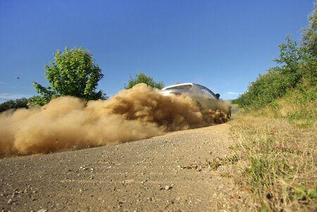 racing sport car sliding in dust