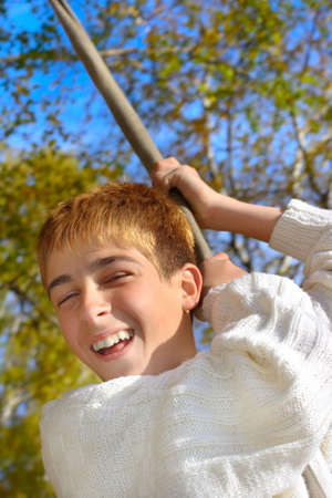 brich: happy teenager jumping on the bungee in the autumn forest