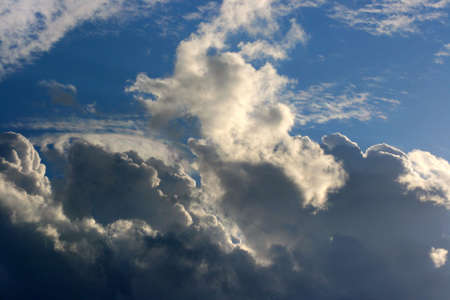 contrasts: Cloud and sunlight contrasts sunbeam and dark clouds