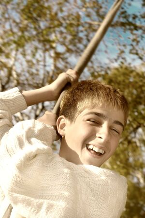 brich: Young and happy teenager jumping on the bungee in the autumn forest Stock Photo