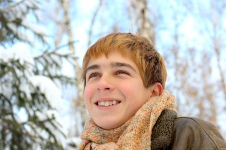 happy smiling teenager in winter forest photo