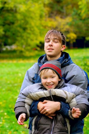 two happy brothers stand in the park  Stock Photo - 16157823