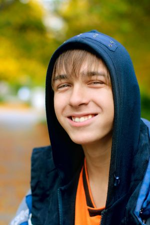 smiling teenager stand in the autumn park Stock Photo - 3830172