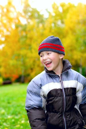 laughing kid stand in autumn park Stock Photo - 3830170