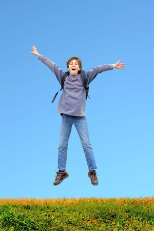 expressing: happy teenager jumping Stock Photo
