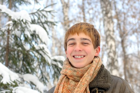 teenager in winter forest photo