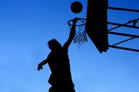 silhouette of basketball player photo