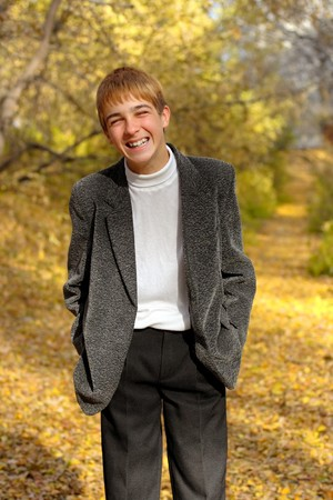 laughing boy stand in autumn forest photo
