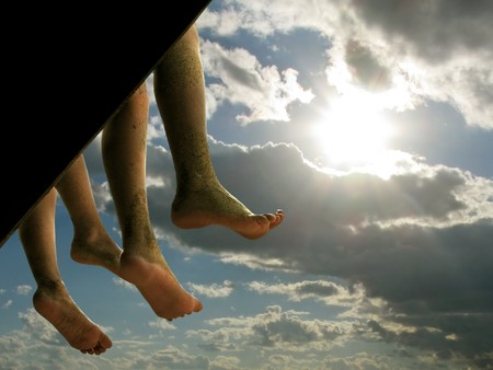 two teenagers legs hanging down