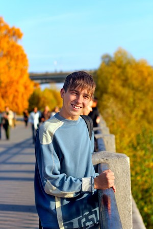 smiling teenager standing on the street Stock Photo - 4491353
