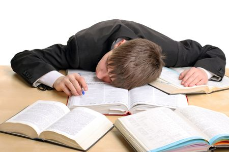 weariness: tired student lying and sleeping on the books