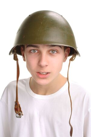 The teenager in a military helmet