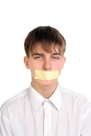 dispirited: sad teenager with mouth sealed  Stock Photo