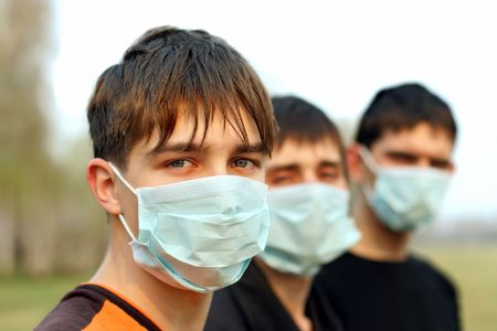 three teenagers in the mask outdoor photo