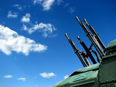 caliber: A large caliber machine-gun on the blue peaceable sky