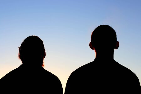 Two Friends silhouette on evening sky background Stock Photo - 5362416