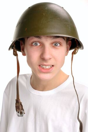 The teenager in a military helmet photo