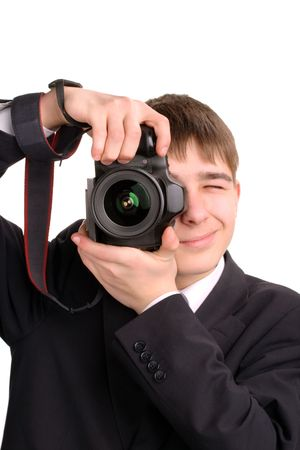 A young teenager gets ready to take a photograph photo