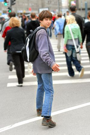 teenager stop on the zebra crossing Stock Photo