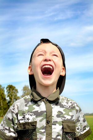 The shouting child on the nature photo
