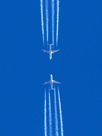 Two planes flying on a meeting each other photo
