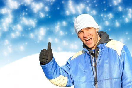happy man with thumb up on the wintner background photo