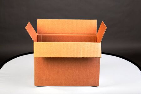 unclosed: Empty brown card box open Stock Photo