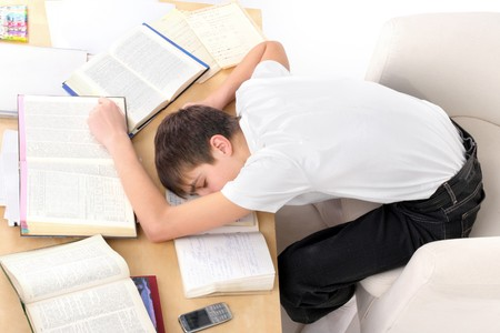 tired teenager lying and sleeping on the books Stock Photo - 7184373