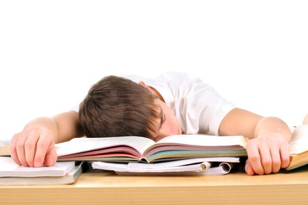 tired teenager lying and sleeping on the books photo