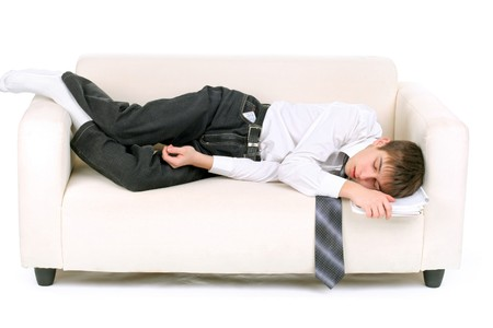 drowse: tired teenager sleeping on the sofa Stock Photo
