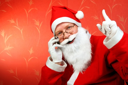 santa claus with mobile phone photo