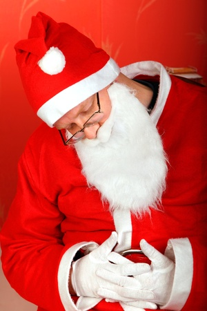 overtired: tired santa claus sleeps in a chair Stock Photo