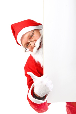 cheerful santa claus with big blank card photo