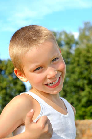 undershirt: portrait of the smiling child boy outdoor
