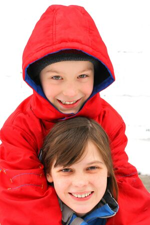 cheerful brother and sister in the winter on the white background Stock Photo - 9333734