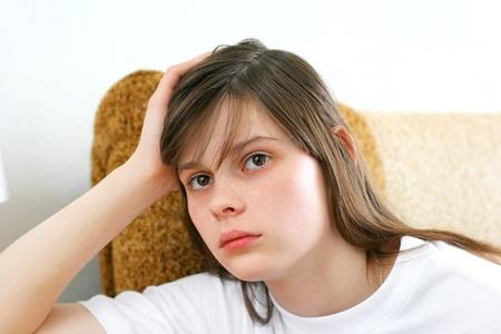 sad teenage girl in home inter Stock Photo - 9333651