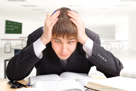 surprised teenager studying hard for the exam Stock Photo - 9333704