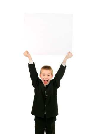 cheerful schoolboy hold blank cardboard isolated on the white Stock Photo - 9324261