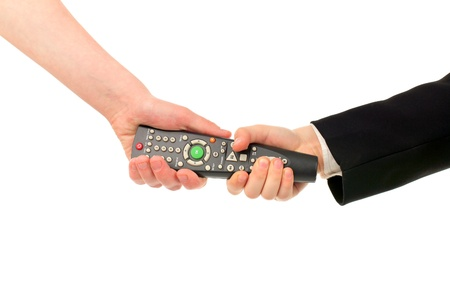 adult and boy hands struggle for remote control isolated photo