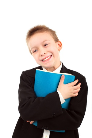 happy boy with exercise book isolated over white background Stock Photo - 9333701