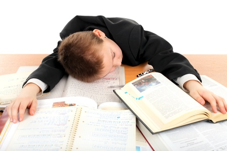 tired schoolboy lying and sleeping on the books Stock Photo - 9333653
