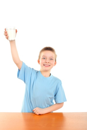 handsome blond boy raising hand with glass of milk Stock Photo - 9324262