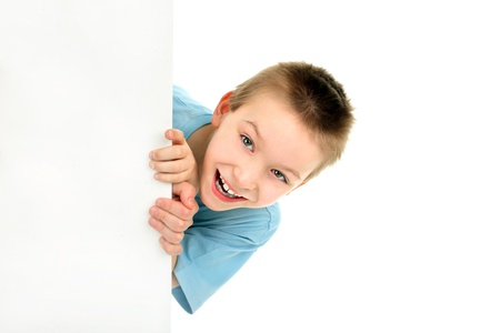 'hide out': cheerful boy with blank cardboard isolated on the white Stock Photo
