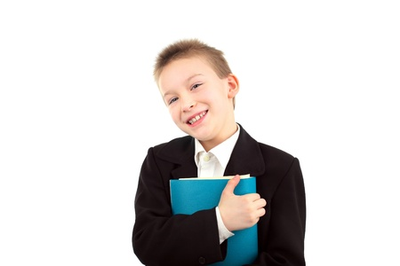 happy boy with exercise book isolated over white background Stock Photo - 9333608