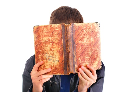 The person hides the face behind the old book photo