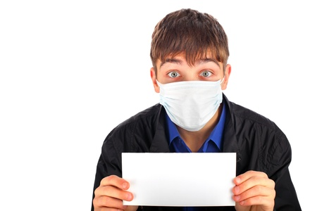 teenager in the flu mask with blank paper Stock Photo - 9380317